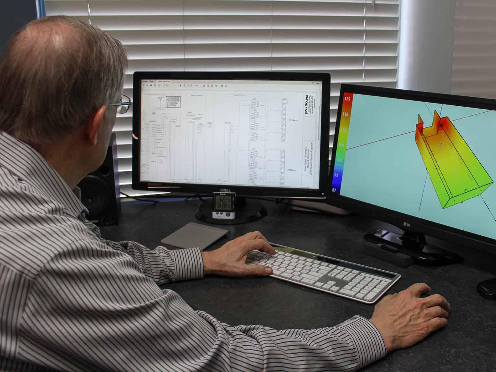Man designing sound system on computer